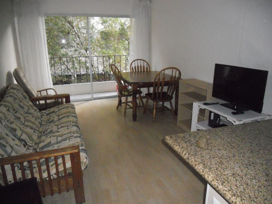 """Living / Dining area with Queen size futon and 32"""" LED TV"""