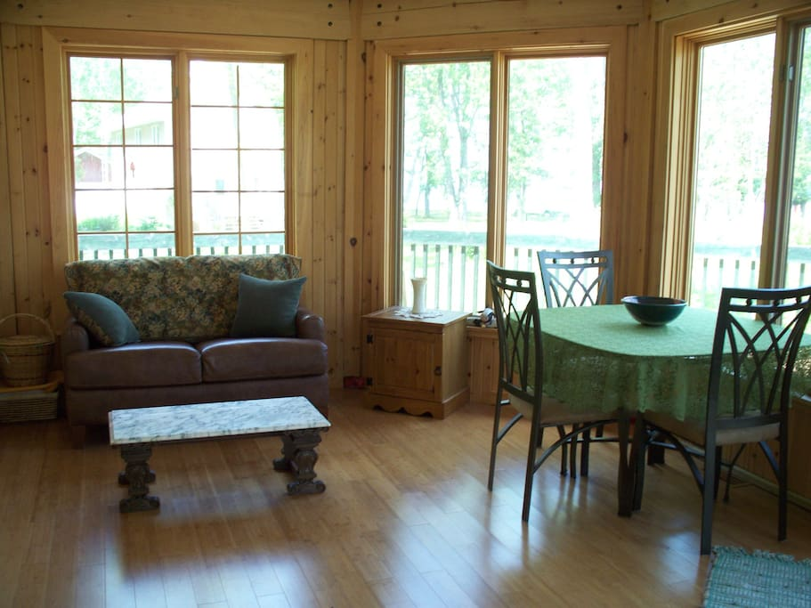 sun room; French doors lead to the Master Bedroom, and sliding glass door to the outside large deck.