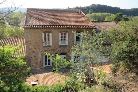 "Our house, with 3 bedrooms available,  is a Maison vigneron with the authenticity of ""real France"" combined with all modern conveniences. In the old Languedoc village of Roquebrun, a truly beautiful region in the sunniest and warmest part of France."