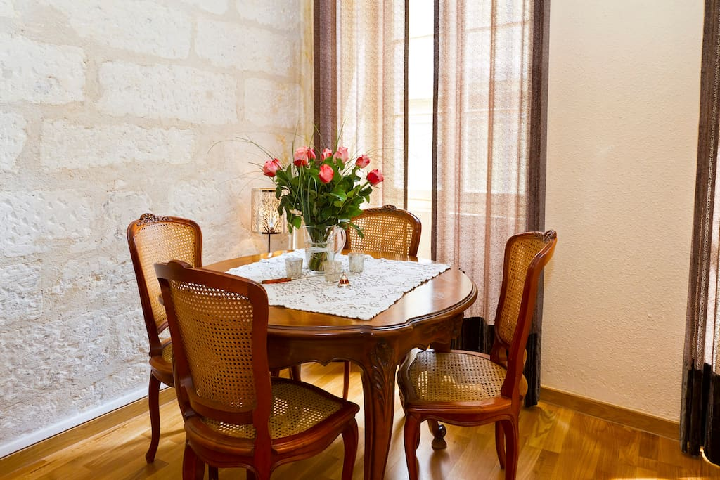 Antique dining set , exposed stone walls