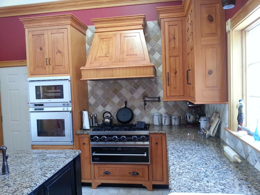 High end Viking professional stove & warming drawer, Gaggenau oven & steam oven, Sub - Zero fridge. Play chef or have fun watching from the granite isle.