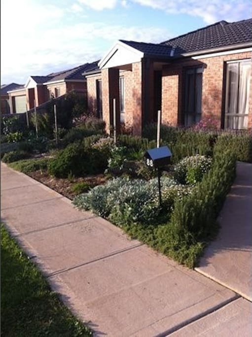 Front of house with herb garden