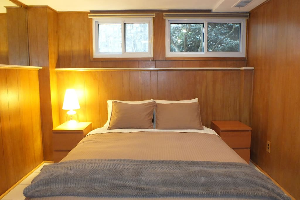 Queen-size european bed with afternoon light windows