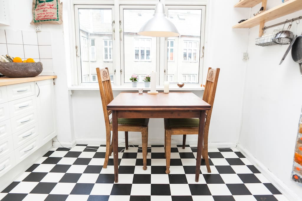 The kitchen gets lots of light, especially in the morning. The second hand dining table is extendable at both ends and seats up to 8 people, if necessary.