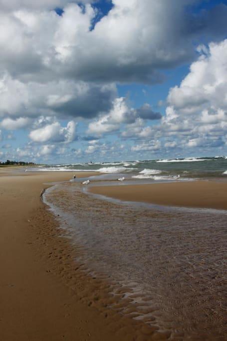 The private beach and Lake Michigan shoreline are a 5 minute walk away.