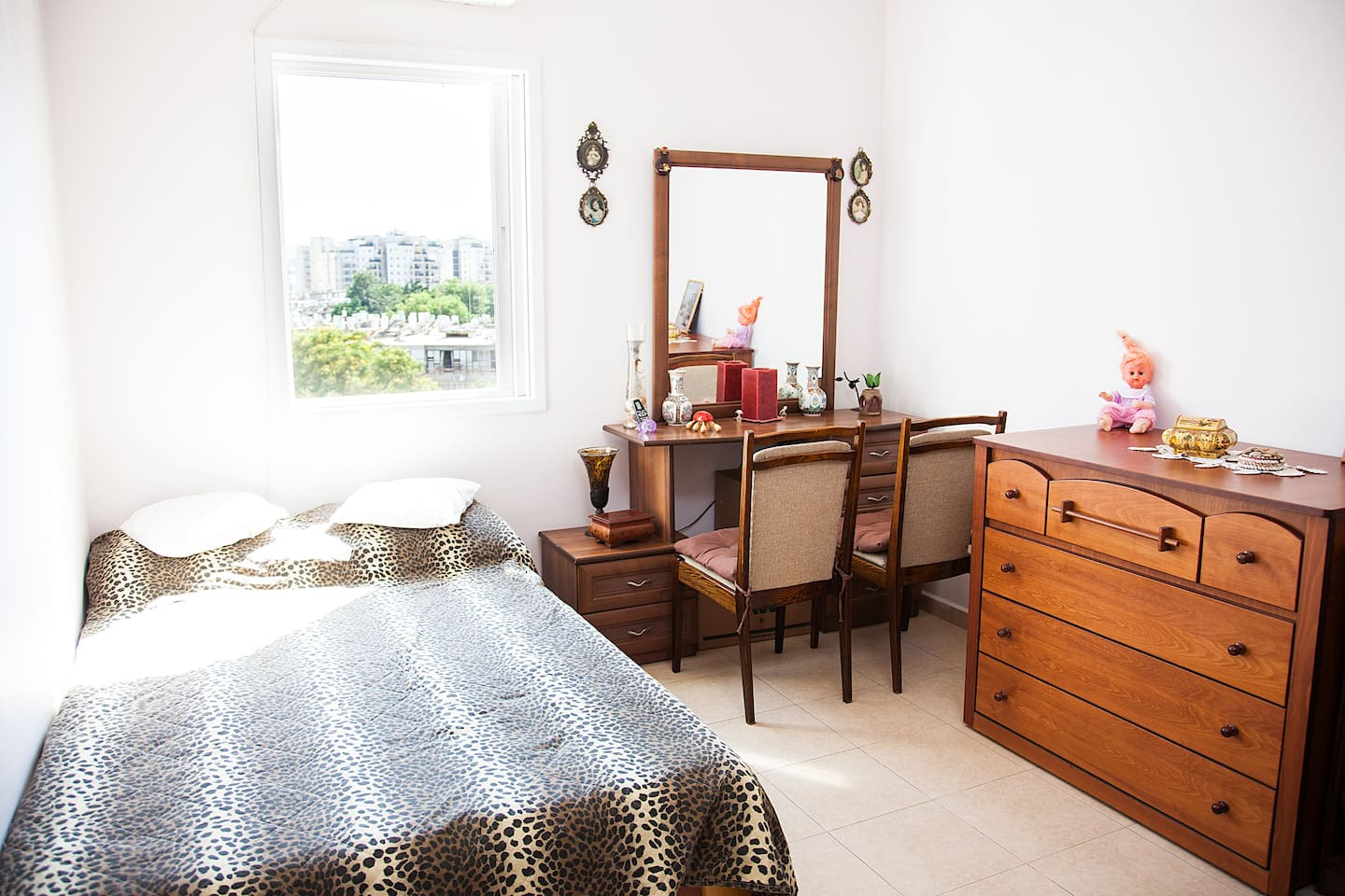 Second bedroom with double futton bed, commode and office desk (air conditioned) overlooking a little garden