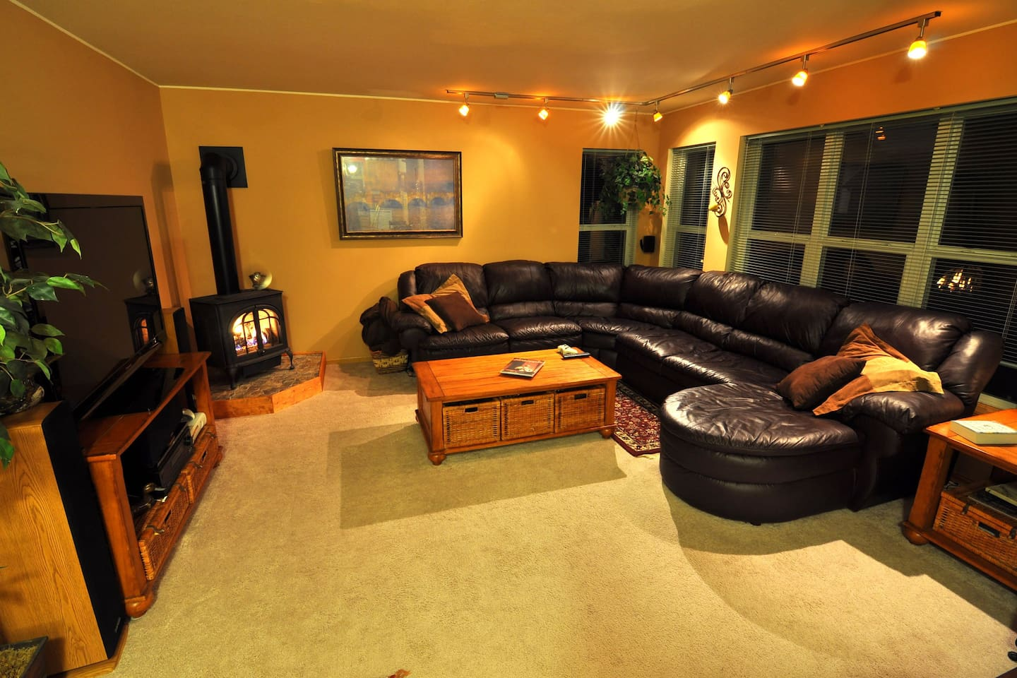 Family room.  Couch can sleep 2 adults comfortably.  54'' HDTV with Dolby Surround, BluRay, Netflix, ESPN, and HBO.  Local Digital Channels as well.