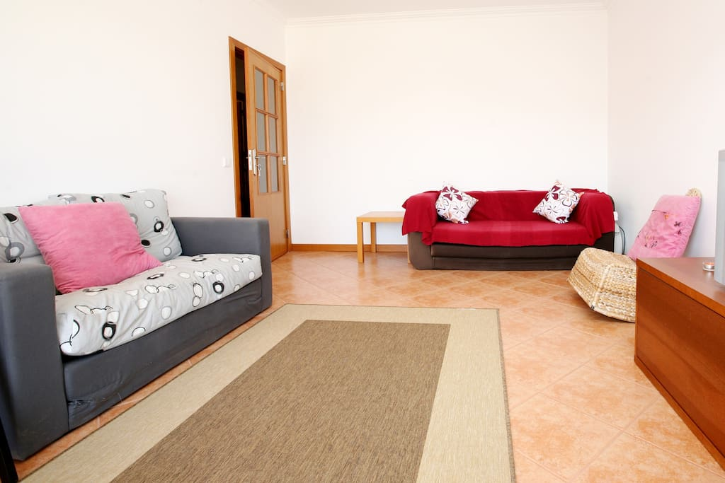 Living room with 1 bedsofa.