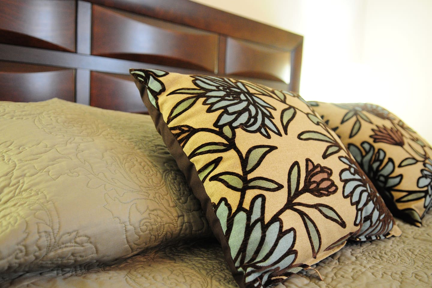 Decorative pillows. adorning bed