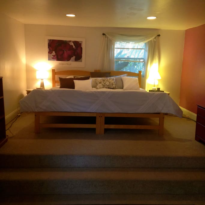 large comfy bed, in a spacious room