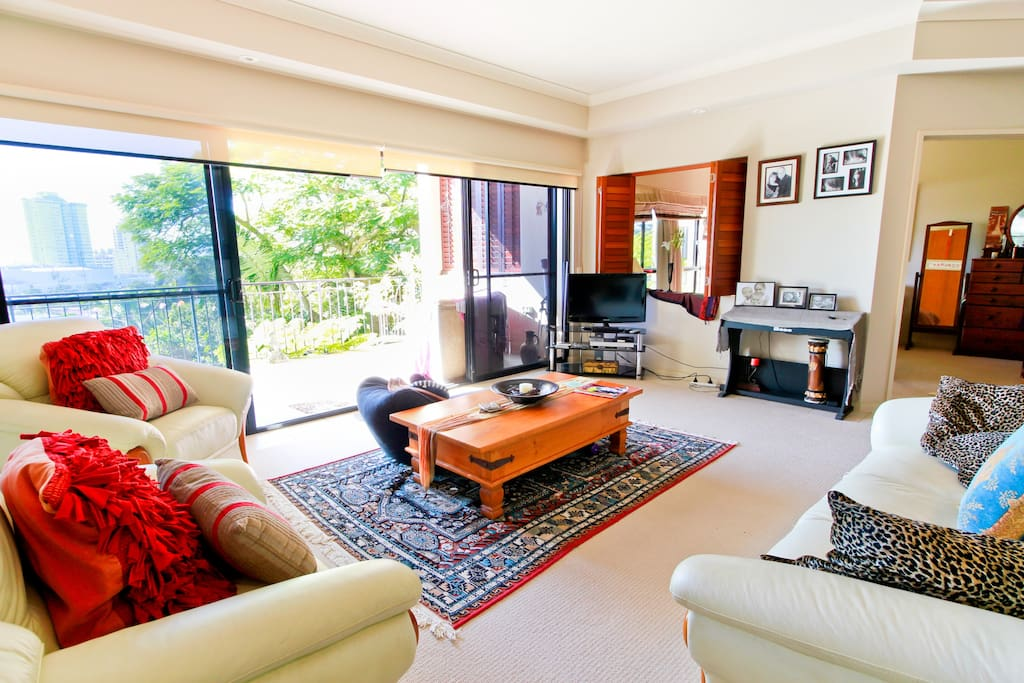 Open plan living/dining area with large balcony which overlooks the village and ocean.