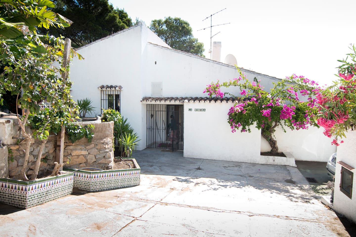 The house is located within a private compound that has a total of 3 houses, there is a gate surrounding the houses and space to park a car.