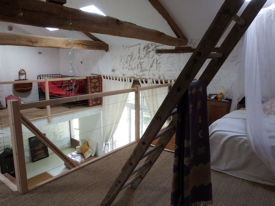 The upper level, double bed with single day bed across