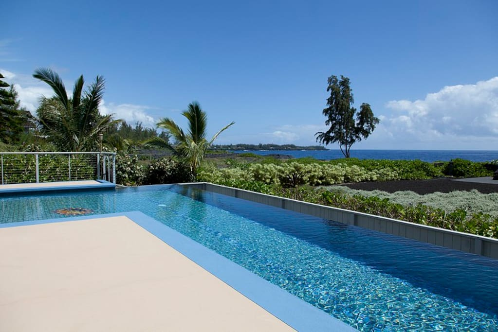 Guests enjoy the 42-foot saltwater lap pool