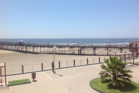 The apartment is in front of the ocean and very near of the Pimentel´s dock . In this place, you have sun all the year. The building has a double entry , on the boardwalk and street. It is located in a completely secure residential area.