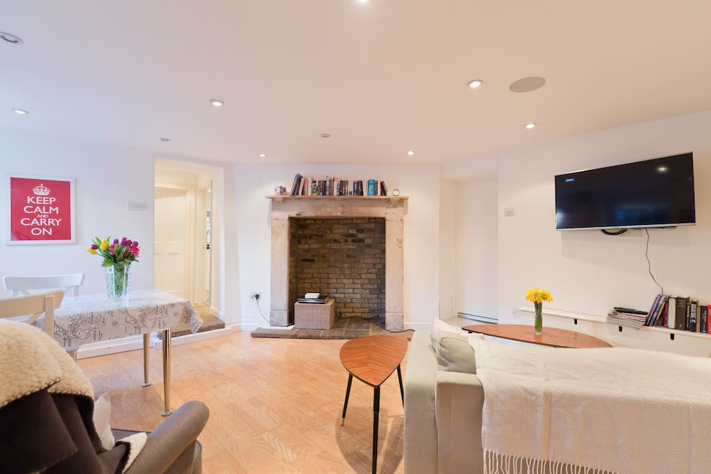 Light and spacious sitting room with dining area, period fireplace and Sky TV