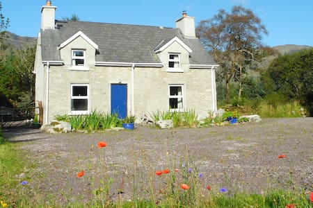 Traditional Stone cottage with private garden on a small farm.  Surrounded by farmland, hills and  countryside. The owners home is nearby and the village of Sneem is 6km away. Ideal as a base to explore Kerry, or for a peaceful rural retreat.