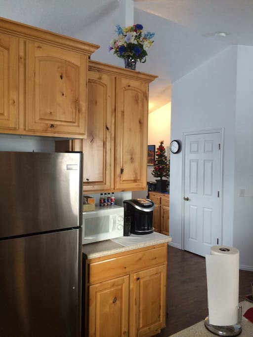 Kitchen is equipped with two refrigerators, microwave and two coffee makers