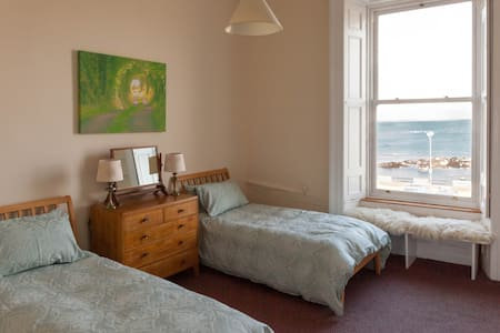 Lovely large bedroom with sea views