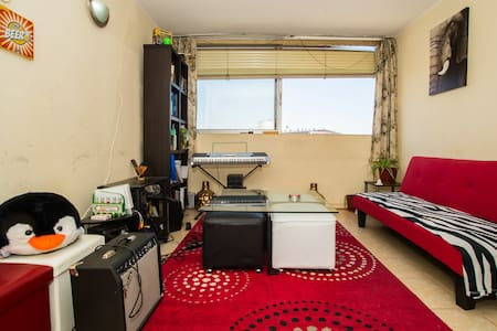 Spacious room in the heart of Stgo!