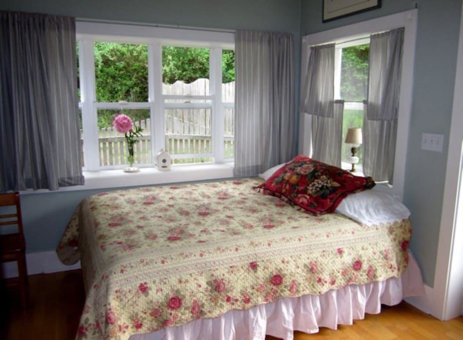 Cozy bedroom with queen sized tempurpetic mattress, down comforter, curtains for late sleepers!