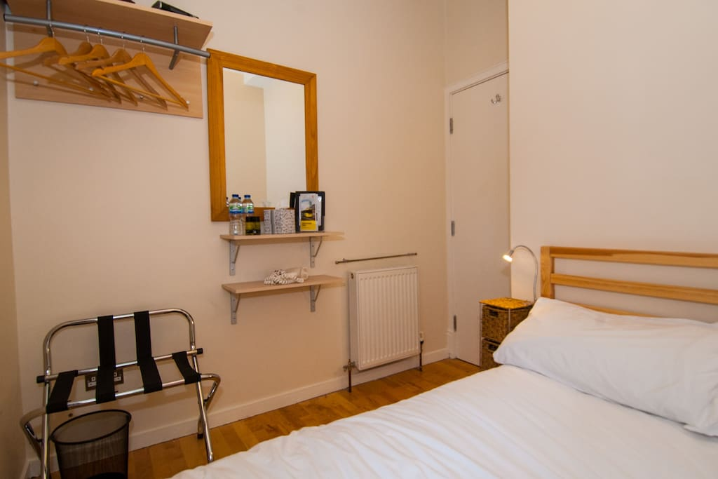 The bedroom - Double bed with Egyptian cotton bedding, complimentary water and toiletries included.