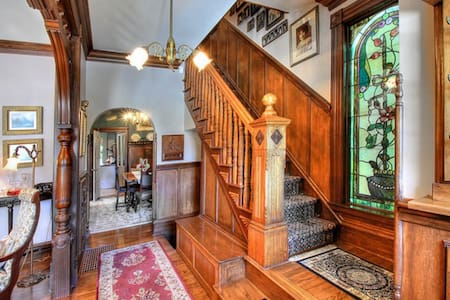 Take a step back in time...in the quaint Tacoma Historical District in this home on the National Historic Registry. Exceptional woodwork, 42 amazing stained glass windows,authentic fixtures and antiques. Comfortably accommodates up to 6 guests.