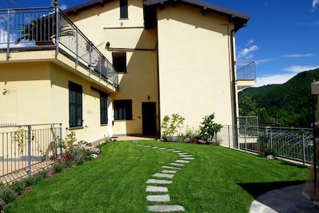Appartamento con vista giardino N°5 - Leilighet