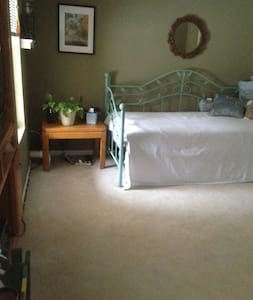 This daylight basement studio features a separate entrance, a  day bed that sleeps two, an entertainment center, a 3/4 bath and laundry facilities which are shared with the homeowner. Kitchen use available. Sweetly furnished.