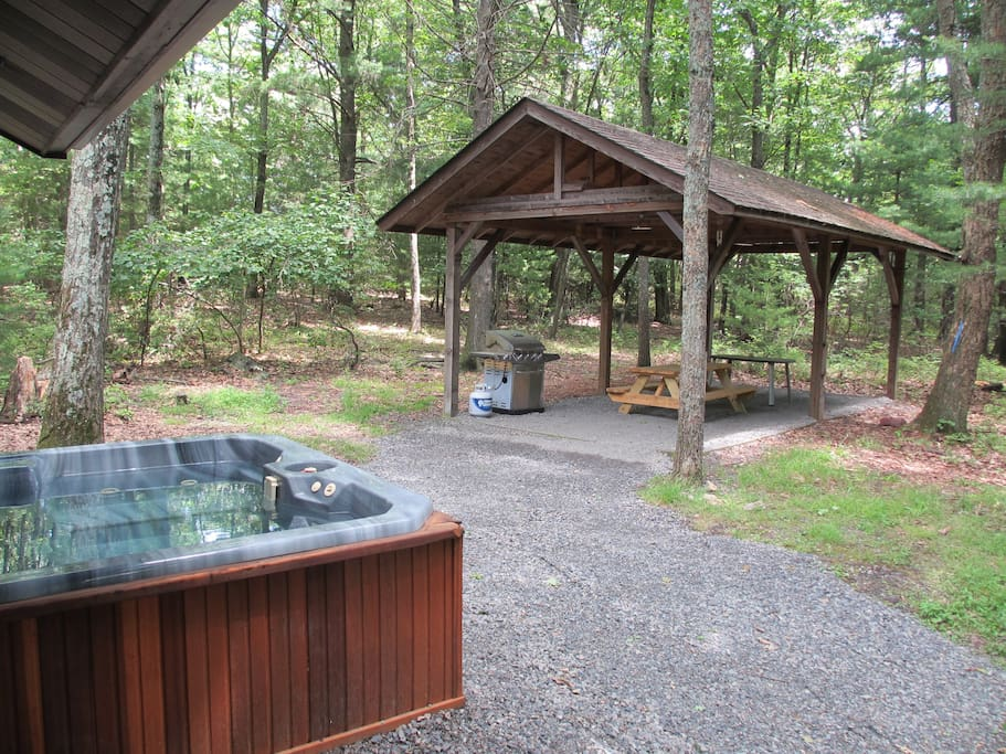 Private pavilion and hot tub, surrounded by forest