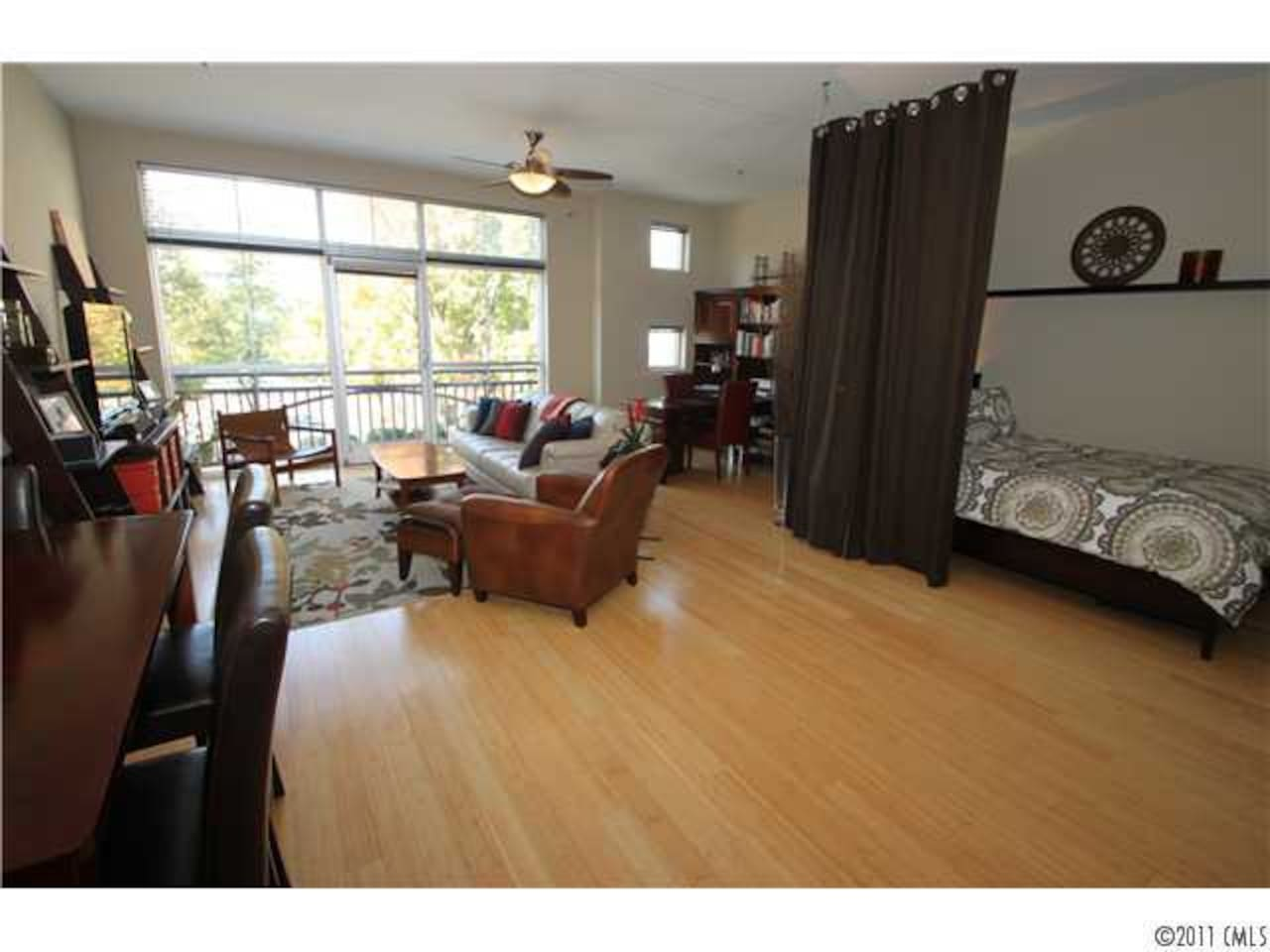 Spacious, airy, light-filled and comfortable. Great view of NoDa right outside your window.