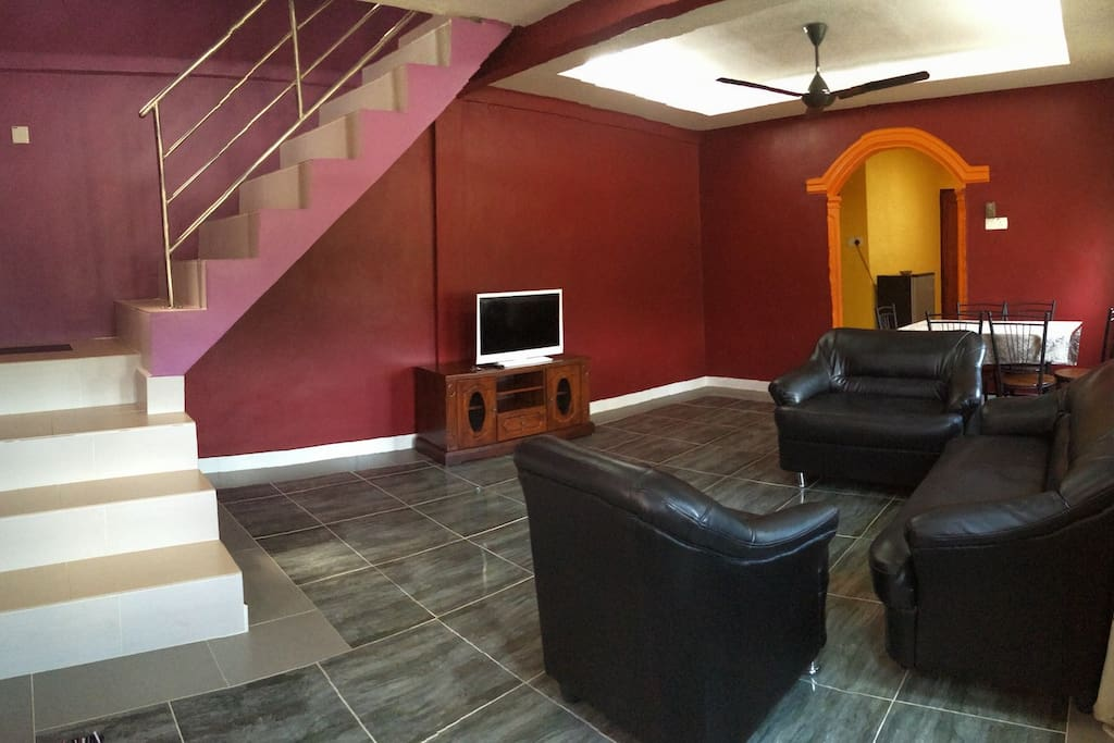 Spacious Living Room, w/ stairs to first floor
