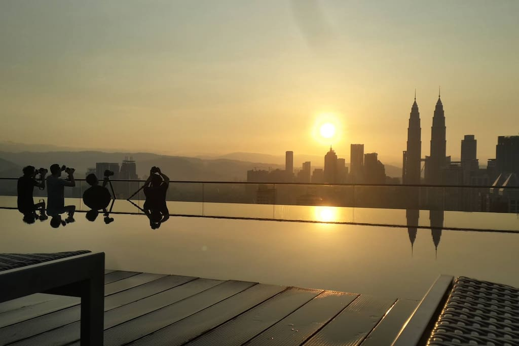 Sunrise from Rooftop at 7am (photographer in left of photo, waiting for sun to come up and take photo)