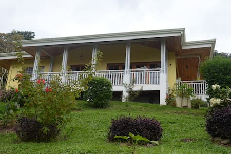 Our two-bedroom bungalow comes with fully equipped kitchen and dining area/living room. From the terrace you enjoy panoramic view of the two volcanoes Irazú and Turrialba (active!). We offer hotel standard service, free laundry, meals at restaurant.