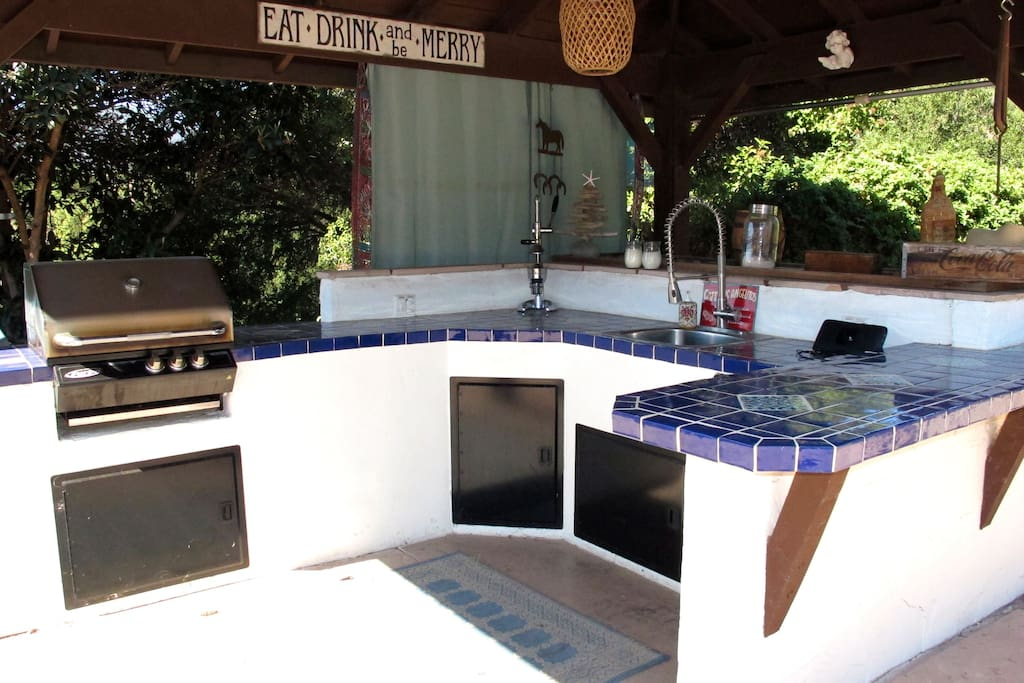Outdoor Kitchen located next to pool and spa and convenient to Main House kitchen.