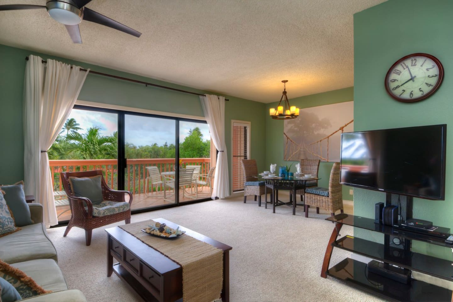 Spacious living room with adjacent lanai and gorgeous mountain views and trade winds.