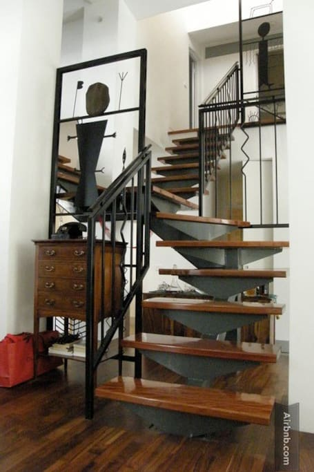 The central staircase heading to the 4 levels that comprise this unique designer house layout