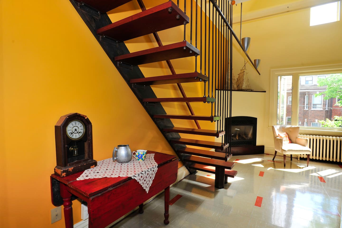The floating stair that leads to the sun infused room.