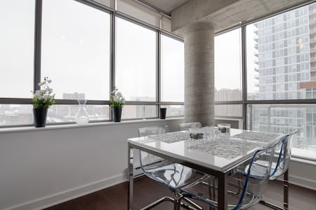 A BEAUTIFUL executive style condo in the heart of Ottawa's Byward Market. With 12' high exposed concrete ceilings and a floor to ceiling upper-level corner view of downtown; this stylishly modern unit provides an exceptional experience of Ottawa.