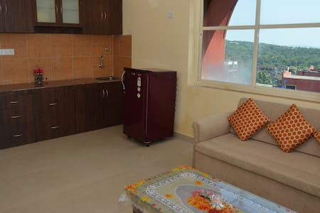 Fully Furnished luxuries 1bhk with balcony.It can accommodate 2 people and 1 extra person on mattress. We have all the 5 star amenities such as swimming pool,club house, gym. The world famous Palolem beach is just 5 mins away from our property.