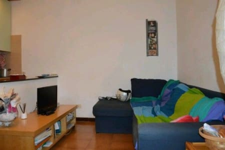 Folded Bed & Couch in Living Room - Piazza Bologna - Apartment