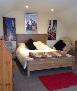 Large loft room with double bed - Casa