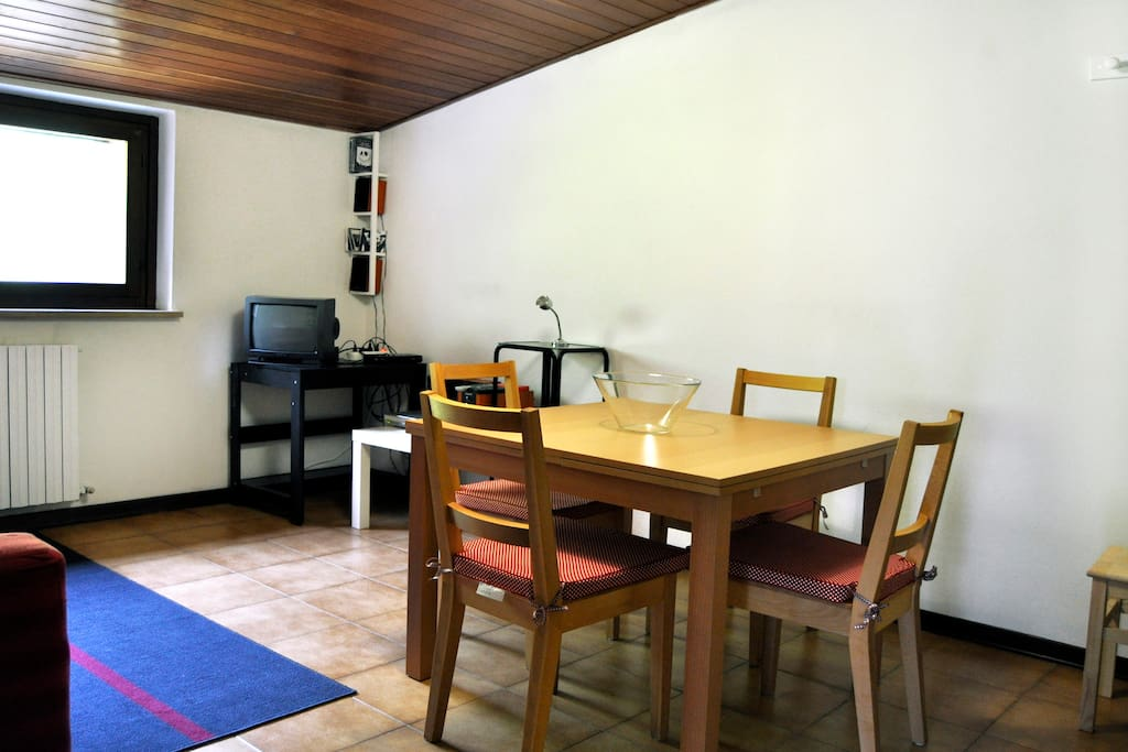 Living Room with extendable table, TV, digital decoder, DVD player, loudspeakers