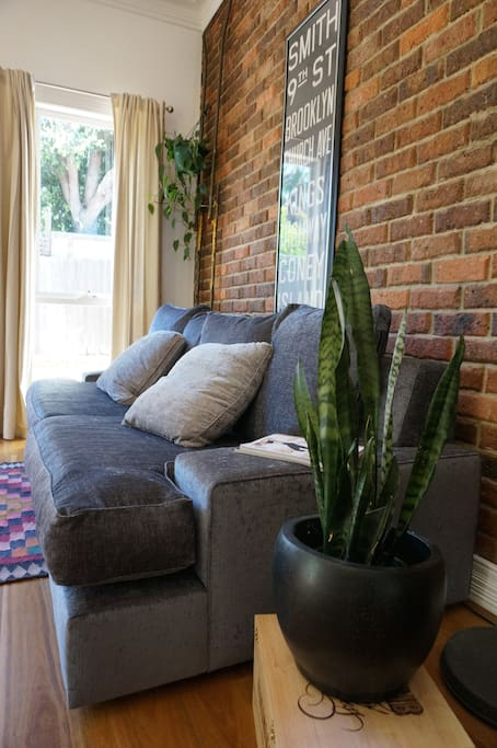 This couch can be used to sleep an extra guest. You can remove the back pillows turning it into the size of a single bed. Super comfortable.