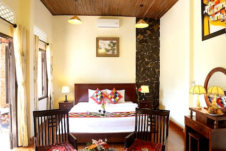The Nice House is designed in the traditional style of Hoi An with its location in the center of Homestays garden. This room is definitely a great choice for family and couples. You will feeling being your home Free bicycly for guests