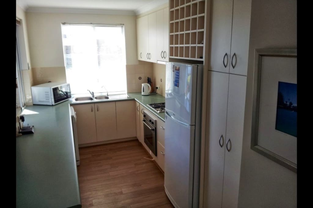 Our kitchen includes full oven with gas hot plate, microwave & dishwasher.