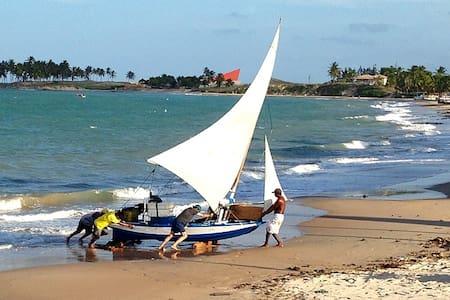 Casa nativa na praia de Maracajaú - Haus
