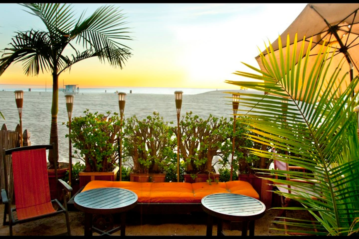 Enjoy our two sun lounge chairs and outdoor dining table right on the beach.