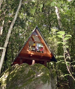 Living on top of a huge rock in a magic forest in Nottoli, our lovely place. The A-frame has the size of a medium tent, nearby is a camp ground for your tent.  Kids up to 6 for free, older than 6 half price, therefor 2 kids you book one extra person.