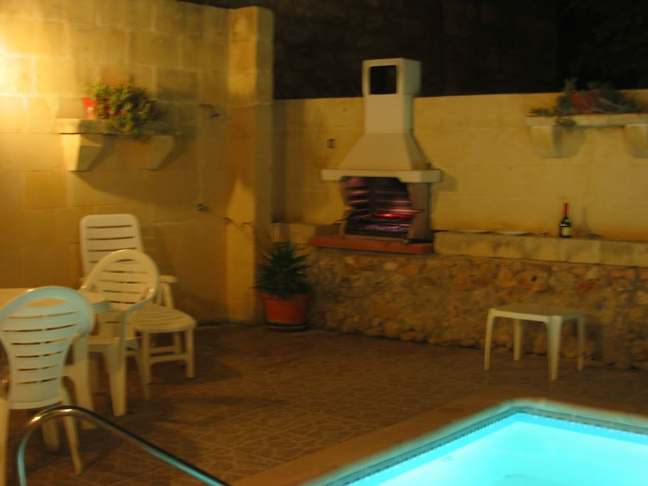 The pool area, showing deck space and also the Charcoal BBQ